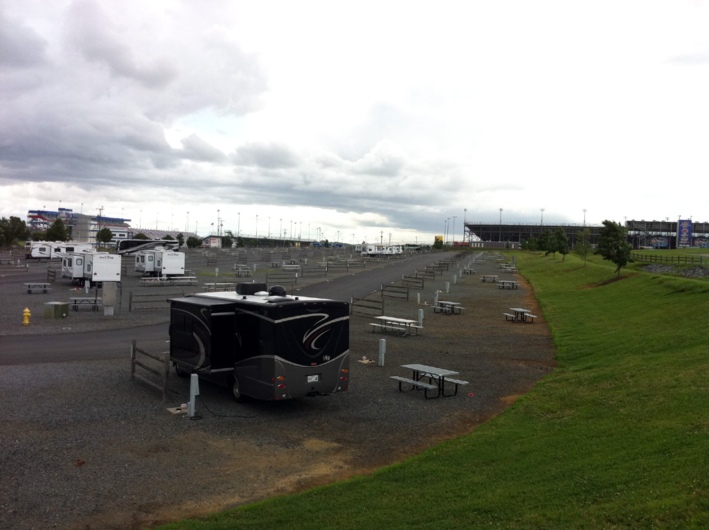 A few RVs parked in campsites at Charlotte Motor Speedway.