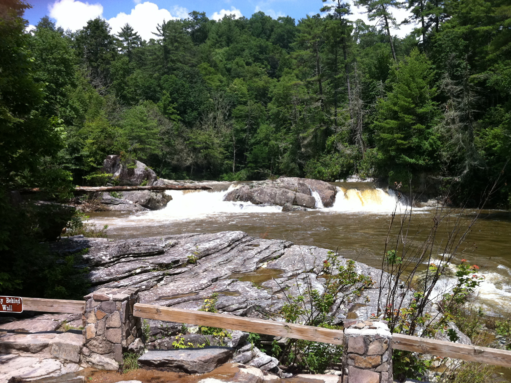 Smaller but beautiful Linville Falls among the trees and rocky shoreline.