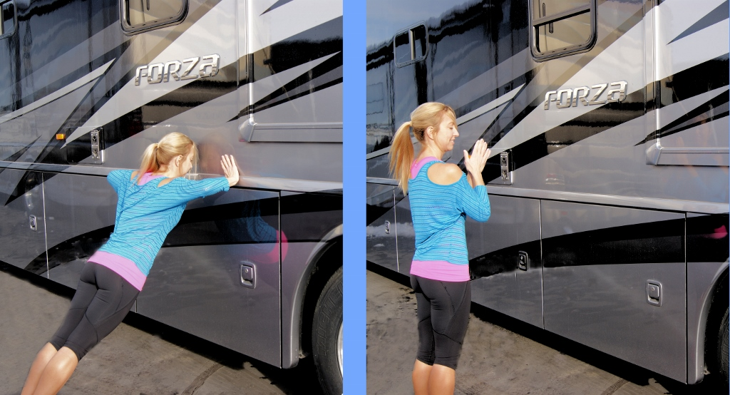 Stef leaning against a Winnebago Forza and pushing off to clap.