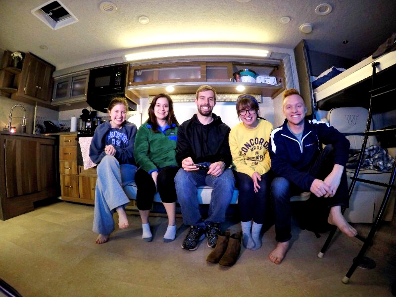 Group of people sitting on couch in RV.