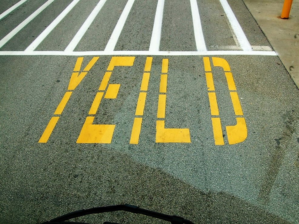 "Yield spelled incorrectly painted on the ground in front of cross walk as""y-e-i-l-d"""