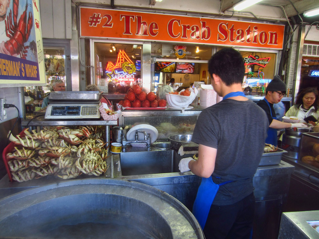 Man cooking in The Crab Station.