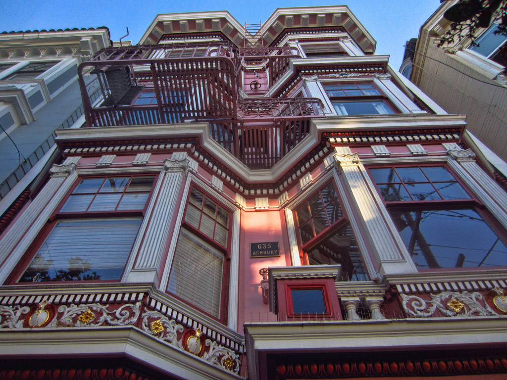 Towering Victorian style apartment.