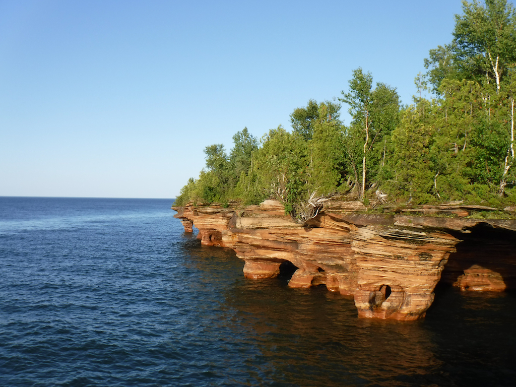 Trees growing out of flaky rock formations that make up the Apostle Islands.