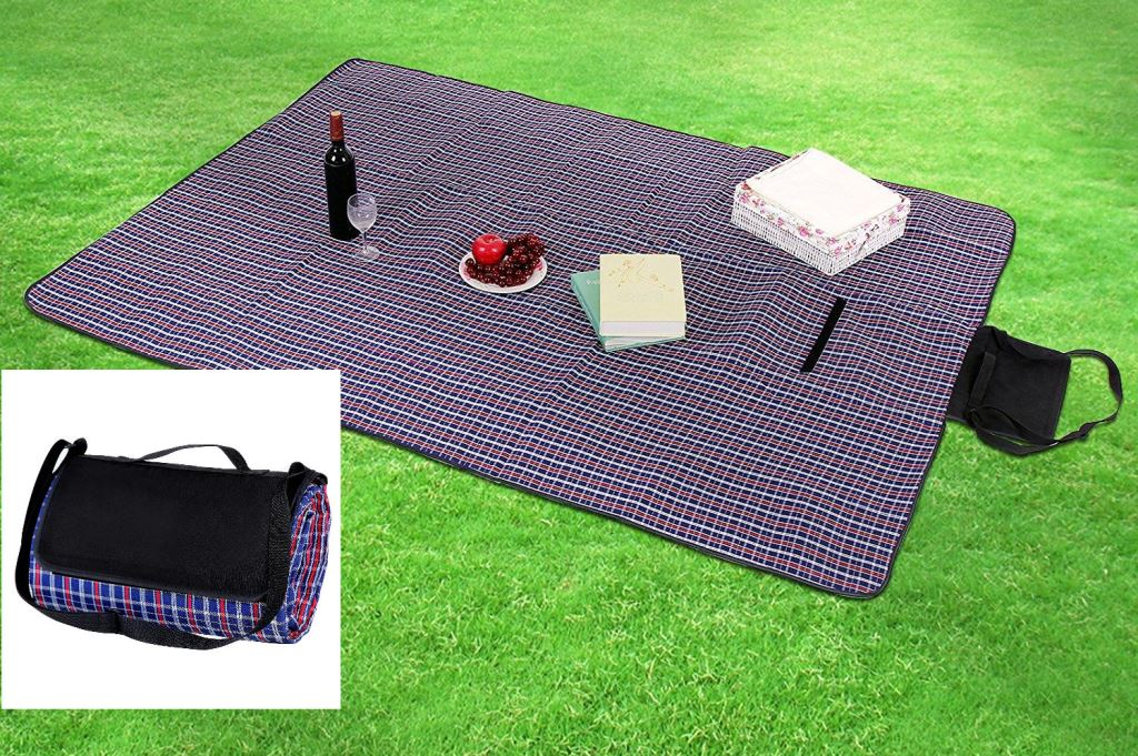 Packable beach blanket shown in stored position; blanket also shown in use, laid out with refreshments, fruits and books on a neatly manicured lawn