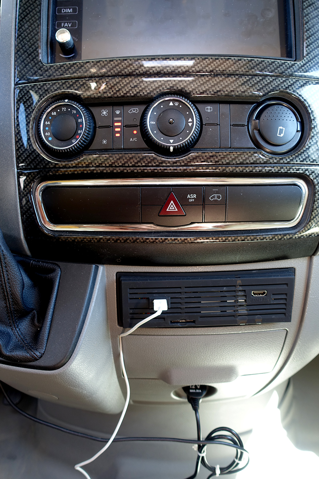Air controls and plug ins on front dash.
