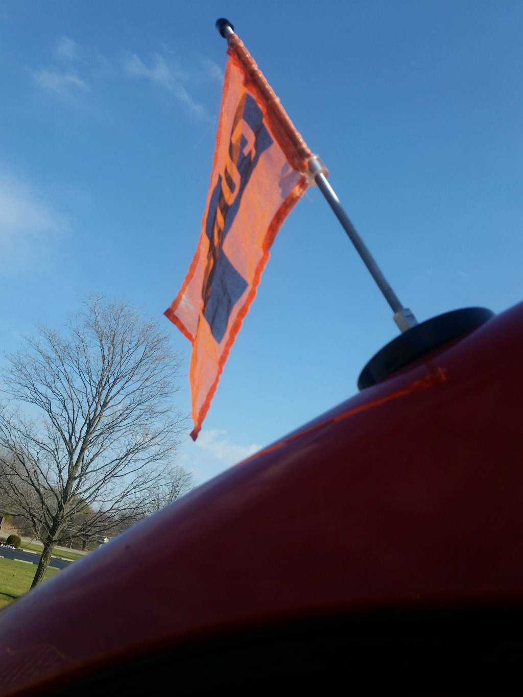 Orange flag flying from the top of an RV.