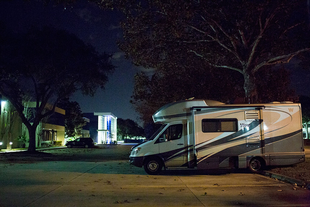 Winnebago View parked in NBC Golf parking lot at night.