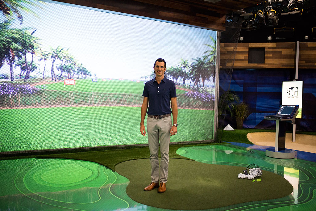 Jordan in front of large screen in Golf Studio two.