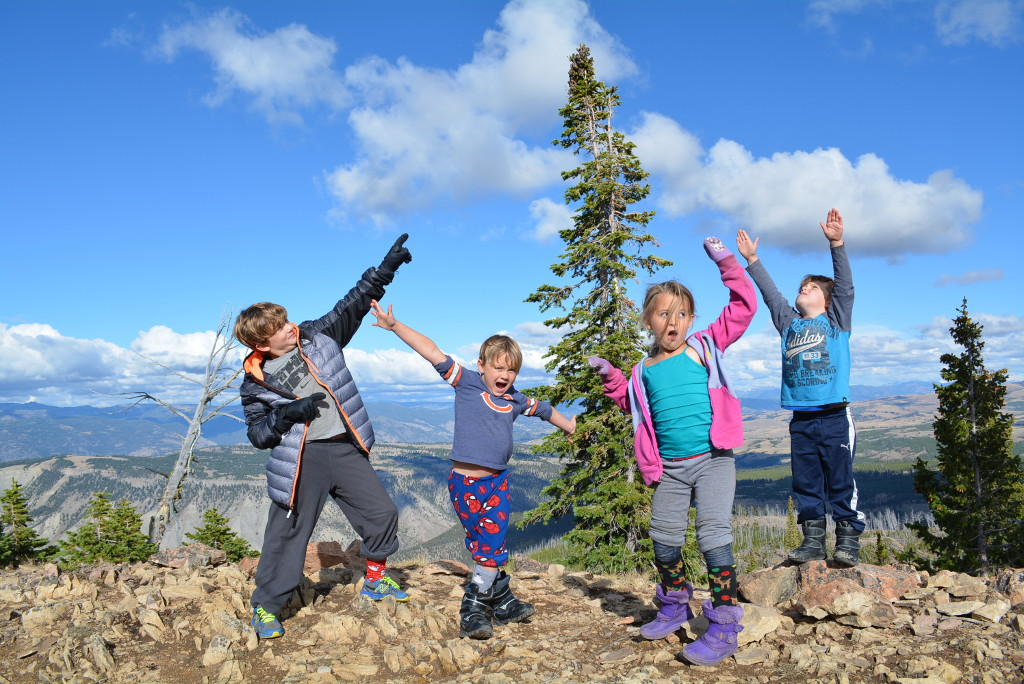 Royal kids standing on rocks posing for a silly picture