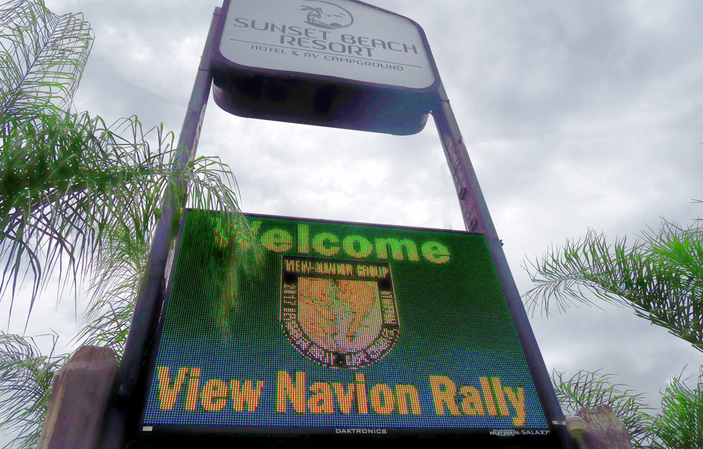 Sign at entrance to Sunset Beach Resort welcoming attendees to the View Navion Rally.
