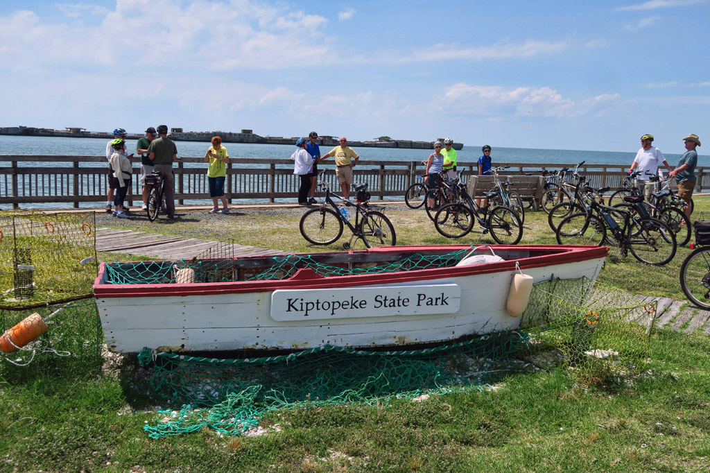 Group standing next to their bikes along the water at Kiptopeke State Park.
