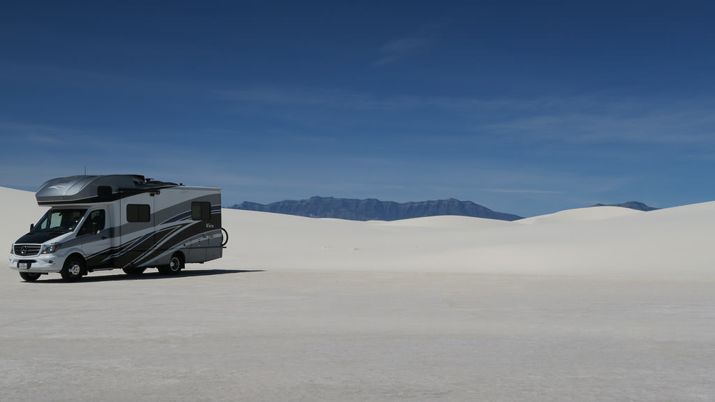 Winnebago View parked on the white sand dunes of White Sands National Monument.