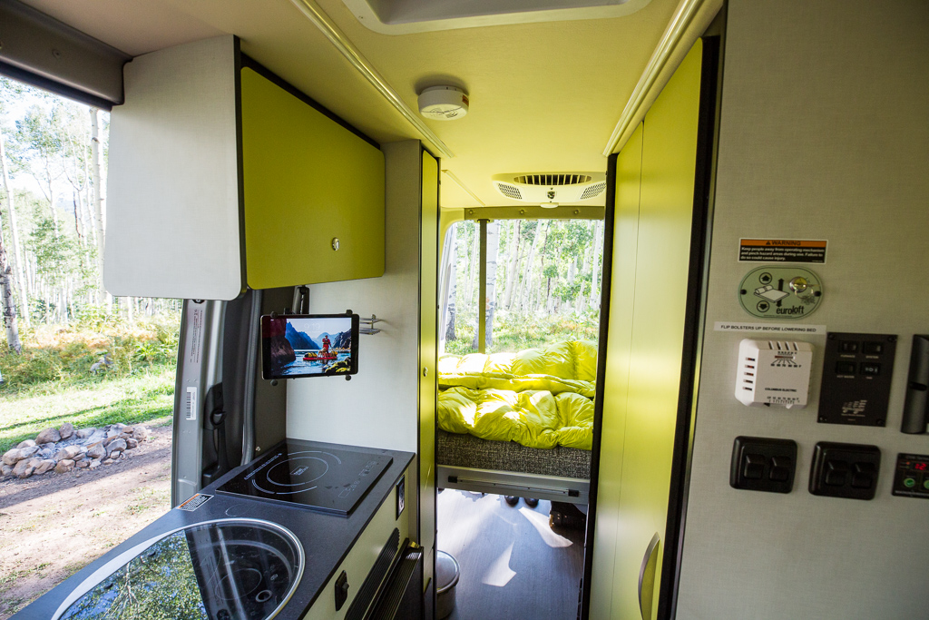 Winnebago Revel kitchenette and bed lowered in the back.