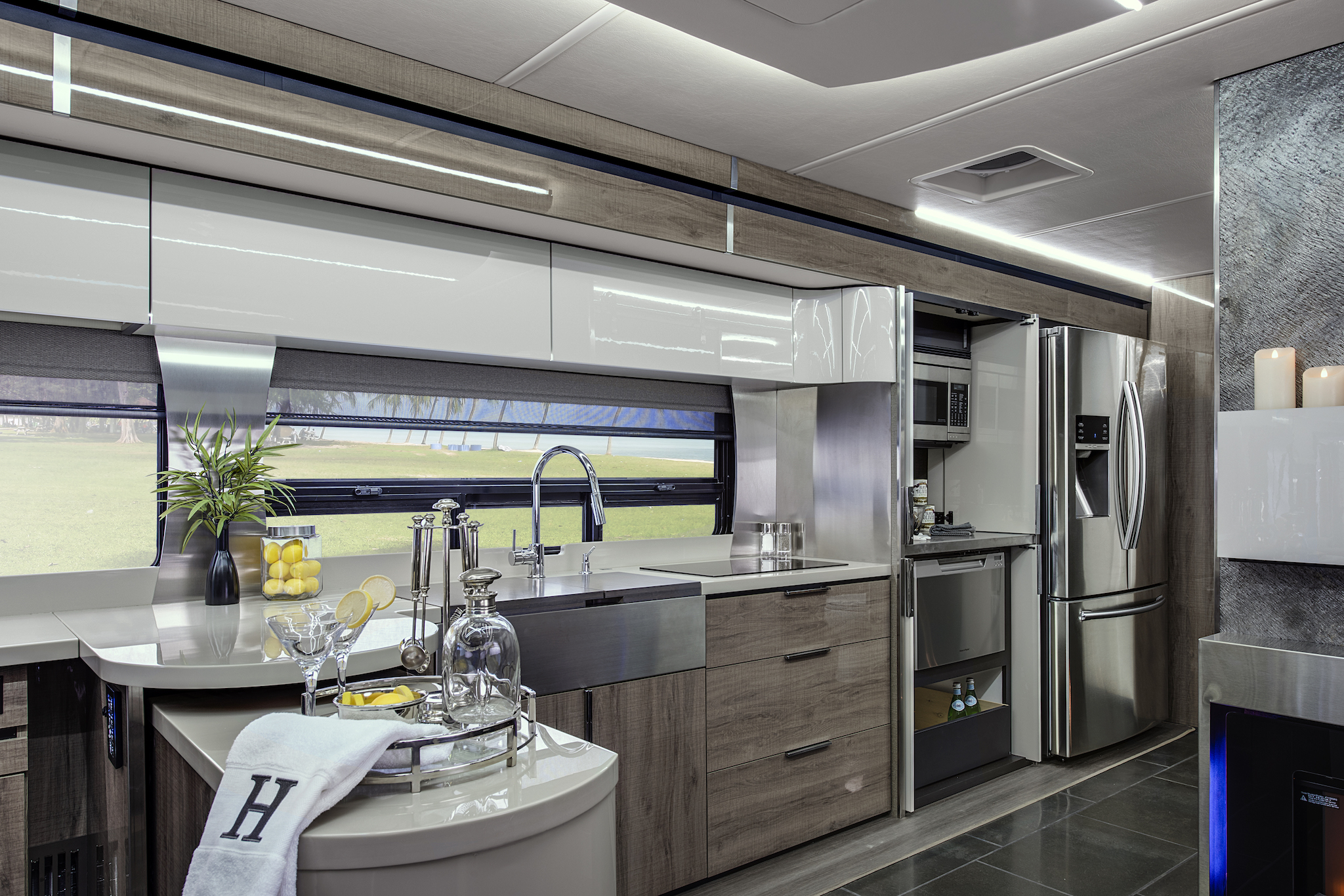 Bright and modern kitchen area of the Winnebago Horizon.