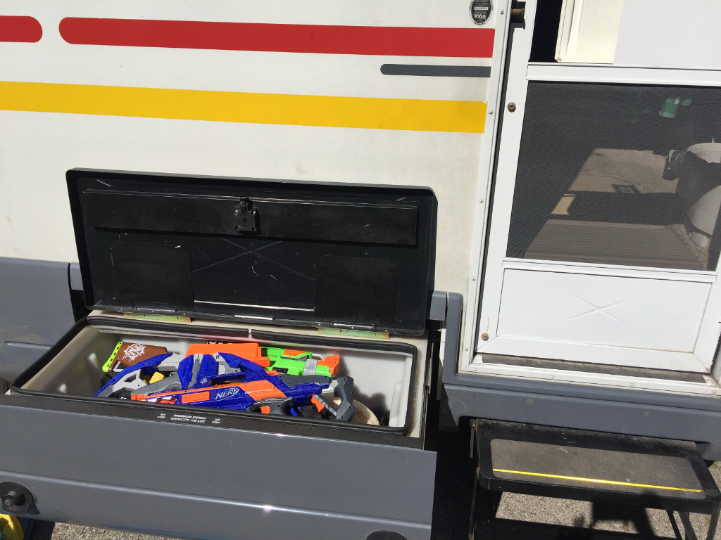 Exterior storage bin full of toys