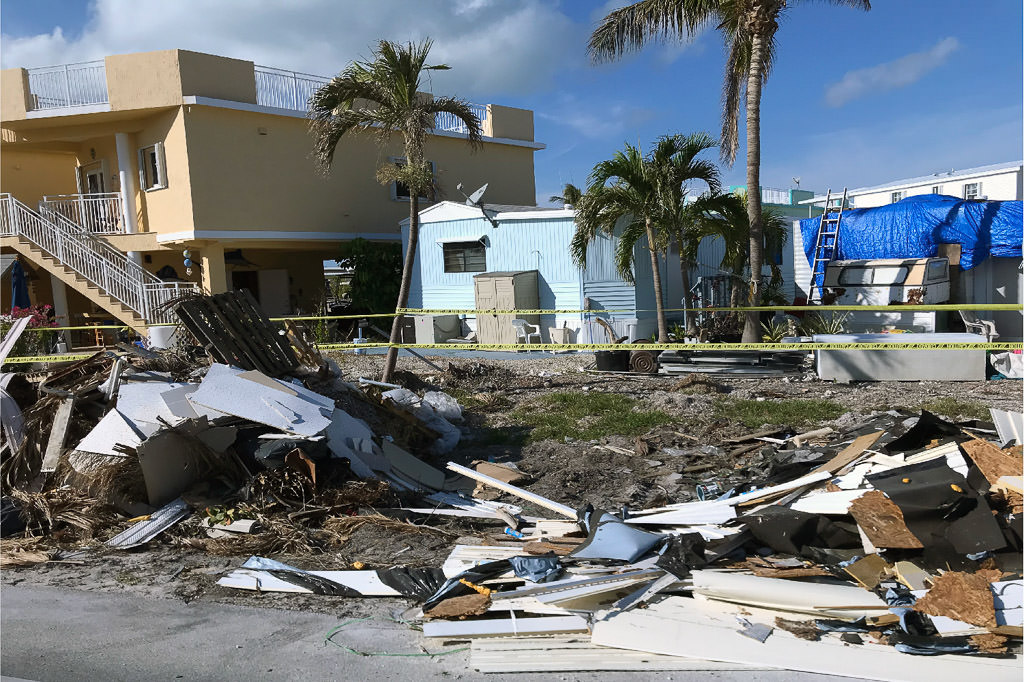 Debris and fallen home on roadside near Key West