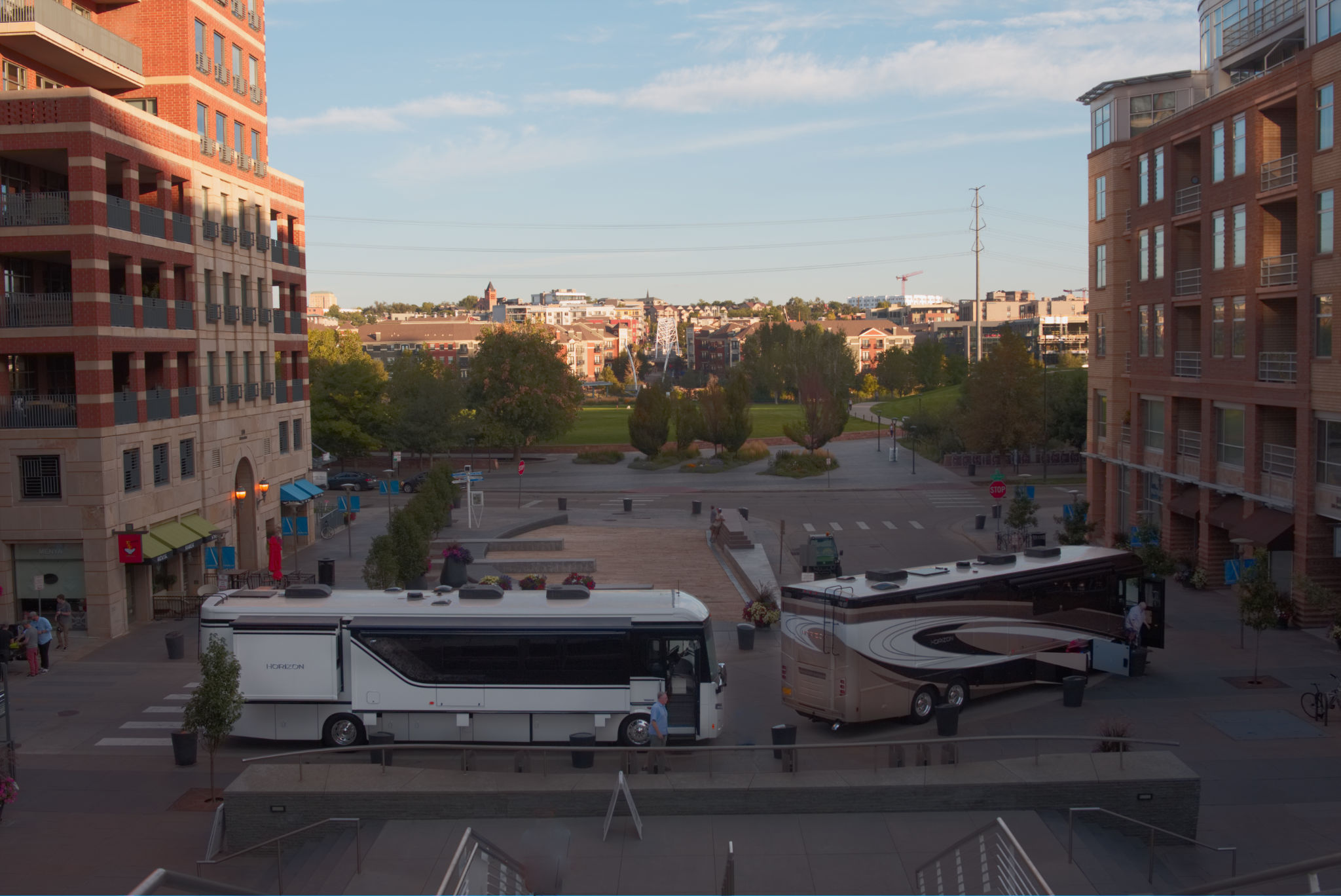 Two Winnebago Horizon motorhomes parked at a turn-around in downtown Denver.