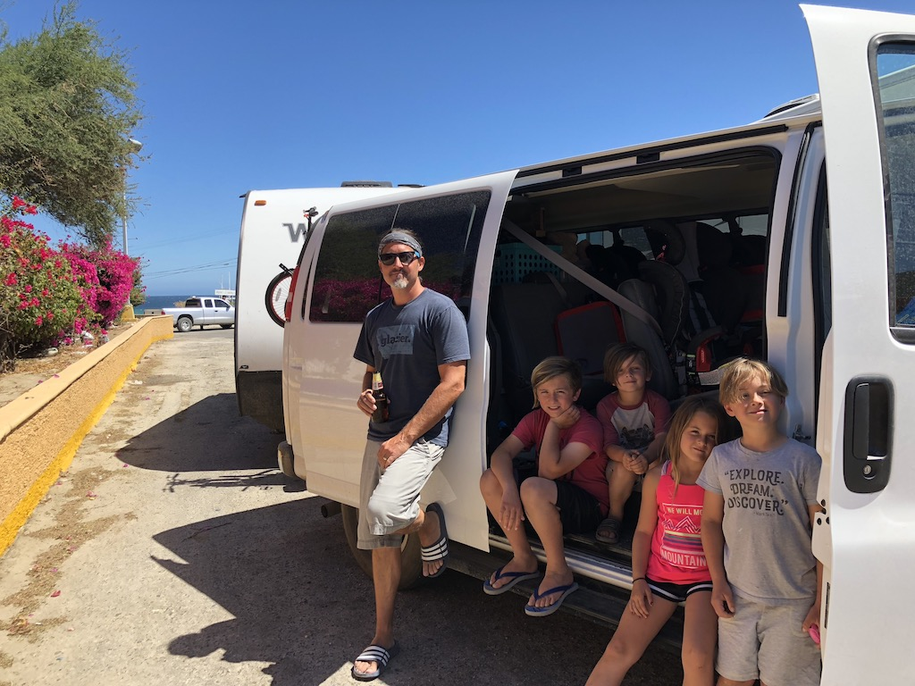 Craig and four kids standing outside of van with Micro Minnie behind it