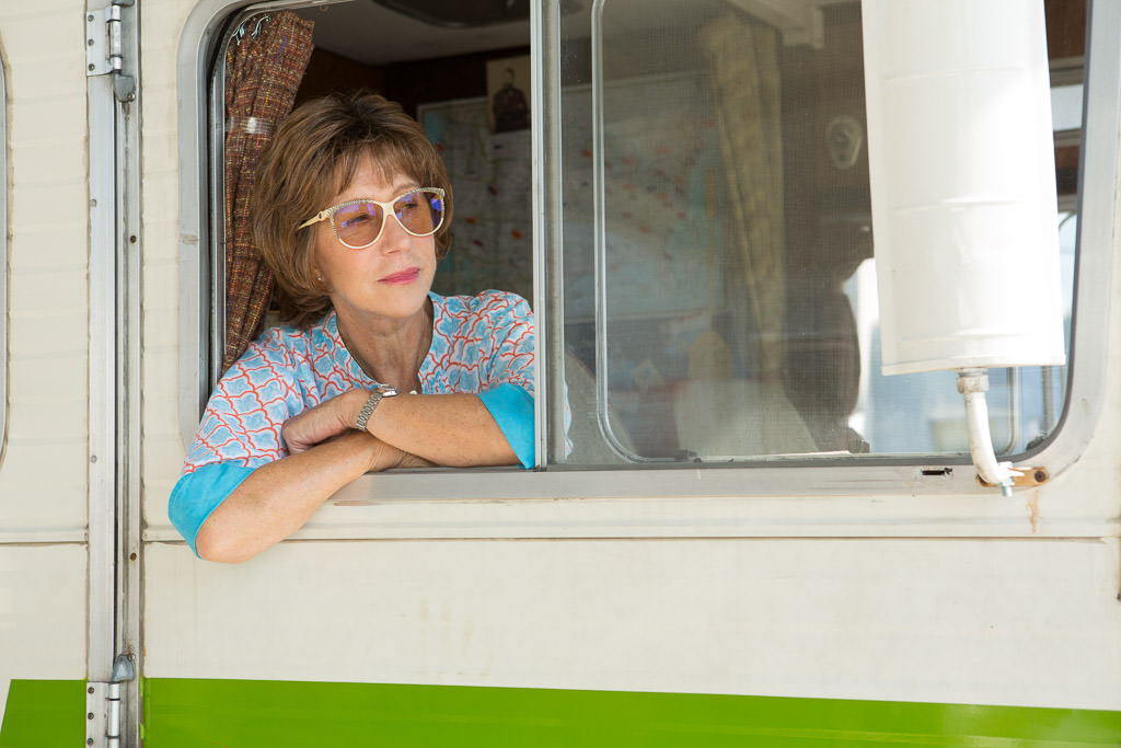 Woman with head out passenger side window onset of movie