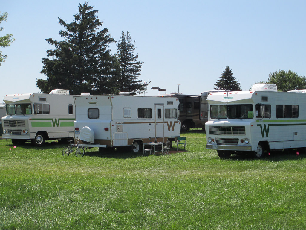 Three Winnebago Indians parked at the Winnebago Grand National Rally