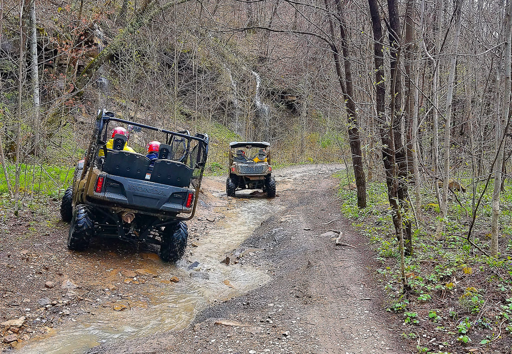2 ATVs on a trail