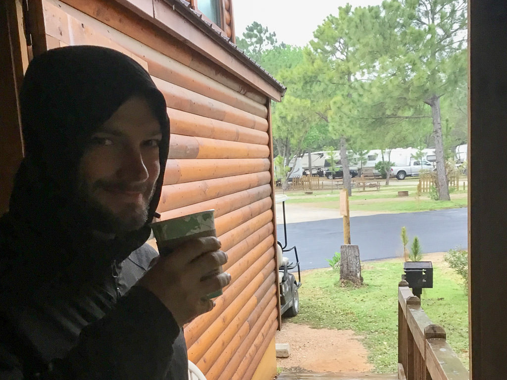 Jeremy drinking coffee in one of the cabins at Jellystone