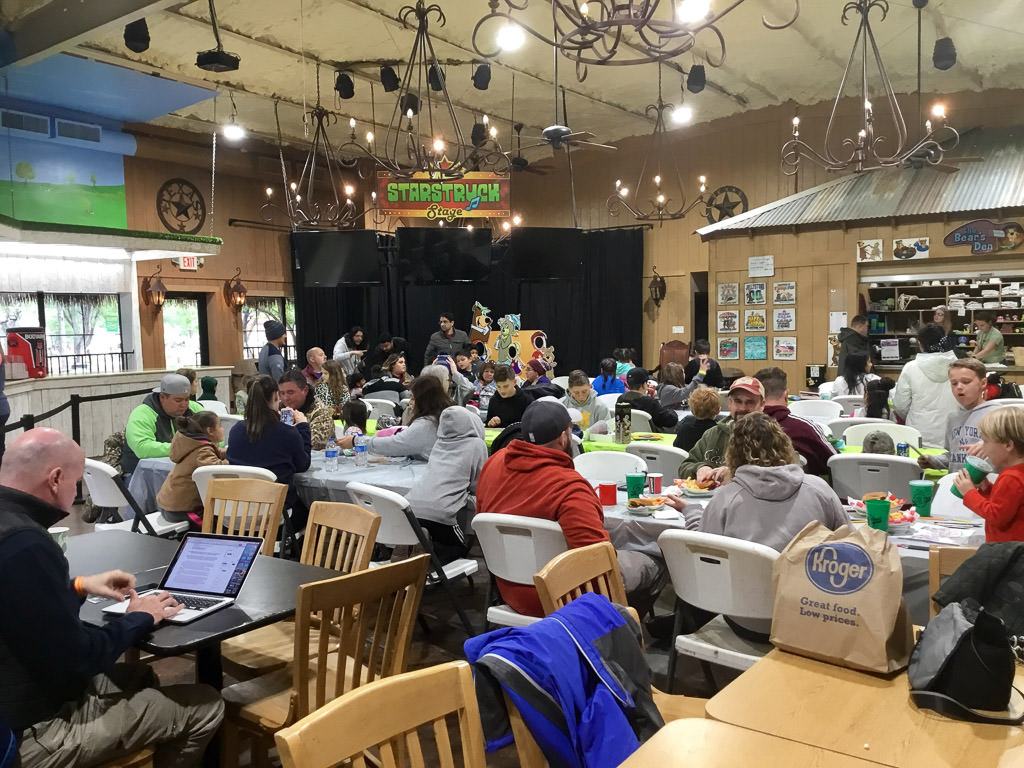 People gathered in the indoor recreation space at the campground