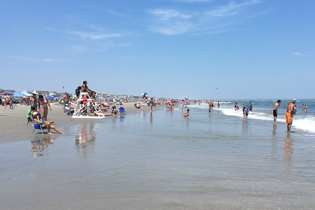 Crowds of people along the beach at Ocean City