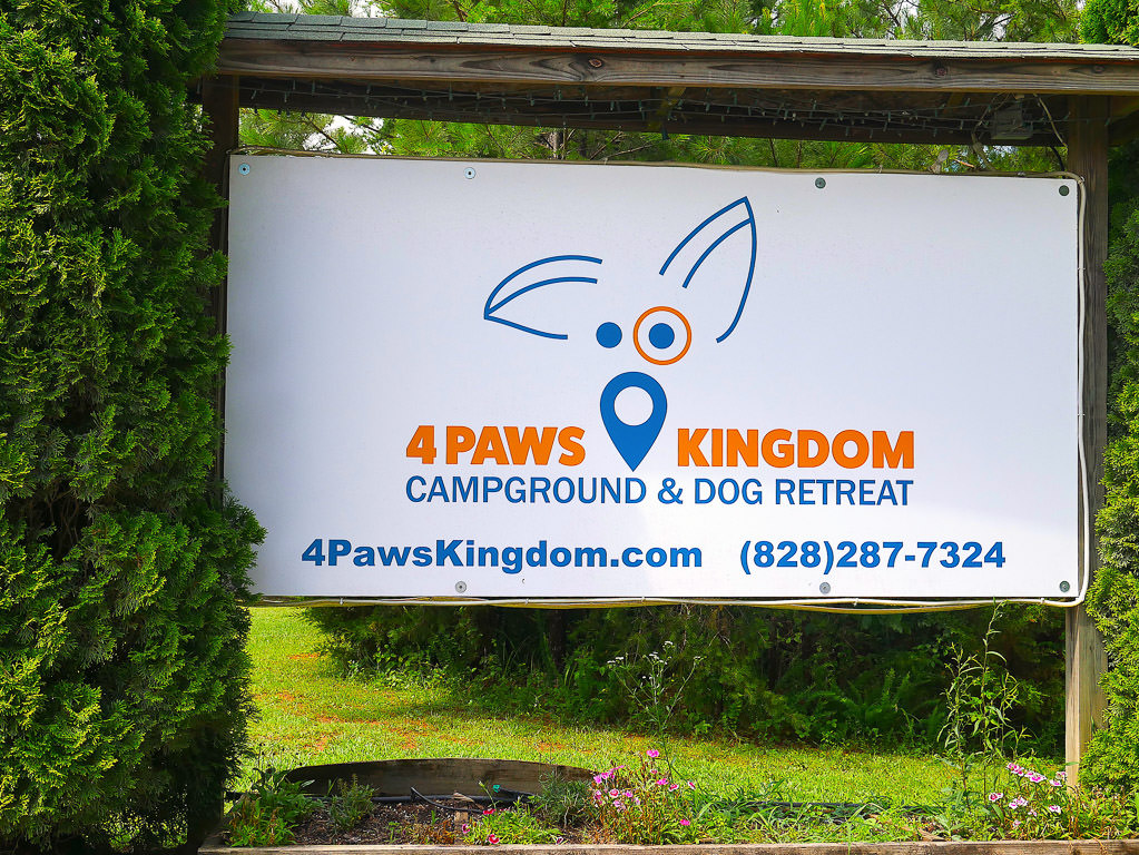 Sign for 4 Paws Kingdom Campground