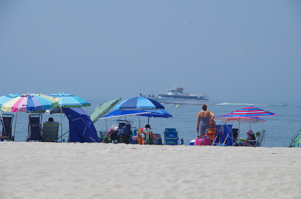 Many people along the beach on Jersey shore