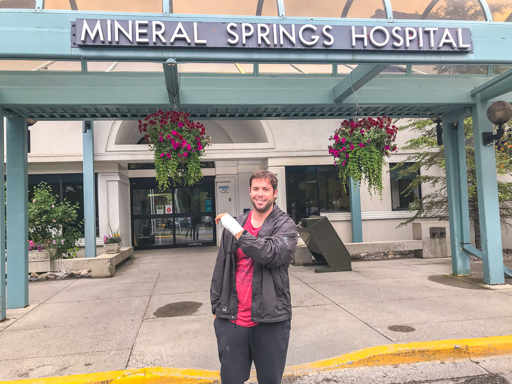 Dan in front of Mineral Springs Hospital with wrapped wrist