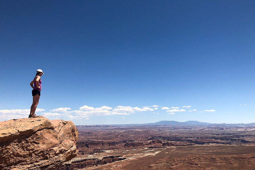 Brittany overlooking the canyonlands from a rocky overlook