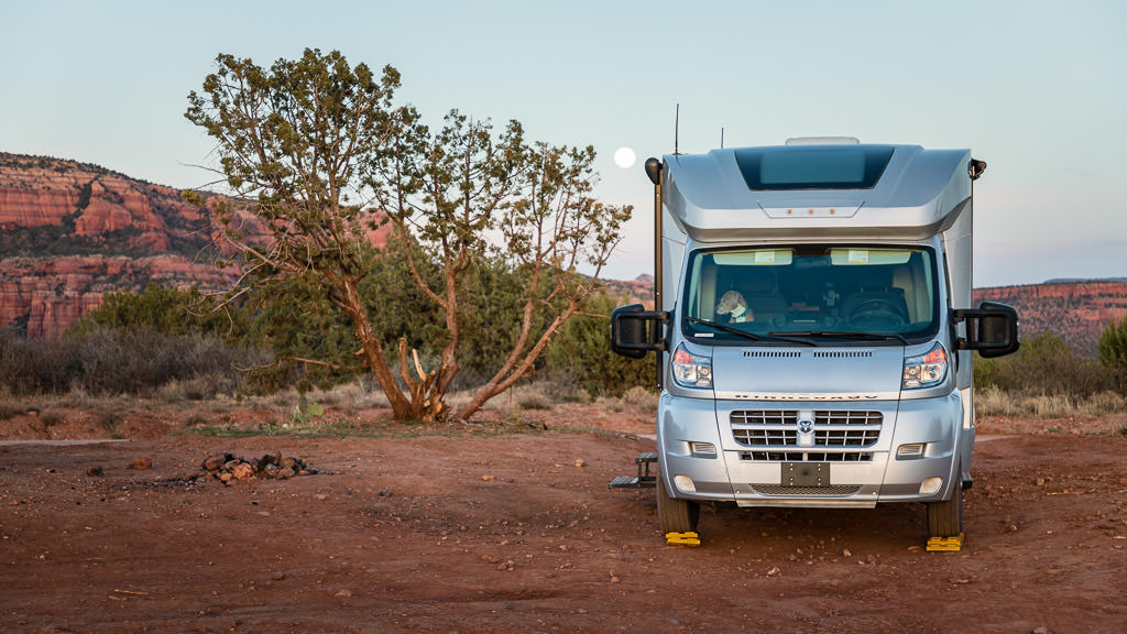 Front view of Winnebago Trend in camp in a desert climate
