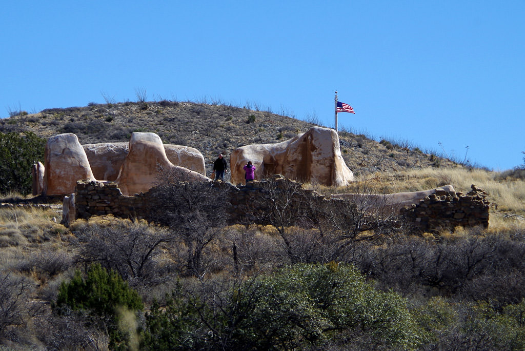 Two people standing on Fort Bowie ruins.