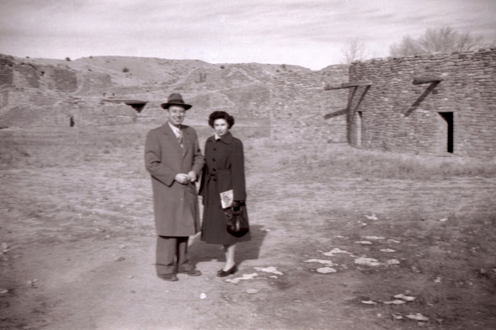 Old photo of Don's parents standing in front of building ruins.