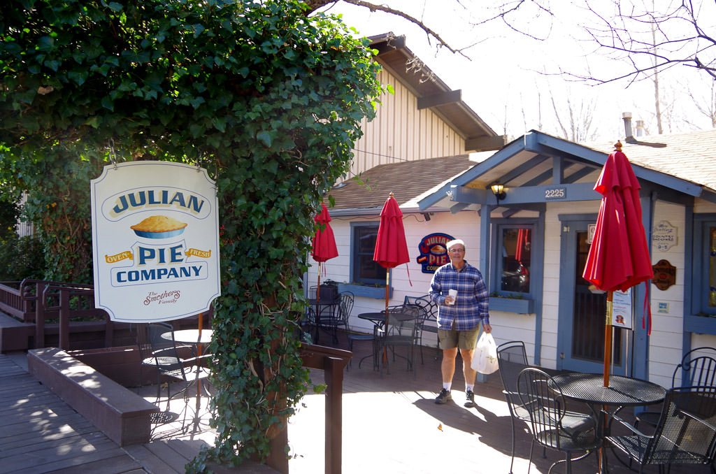 Man standing in front of Julian Pie Company.