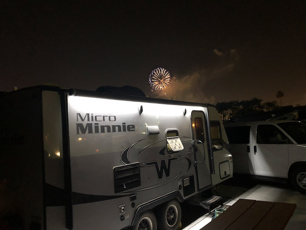 Winnebago Micro Minnie with fireworks overhead.
