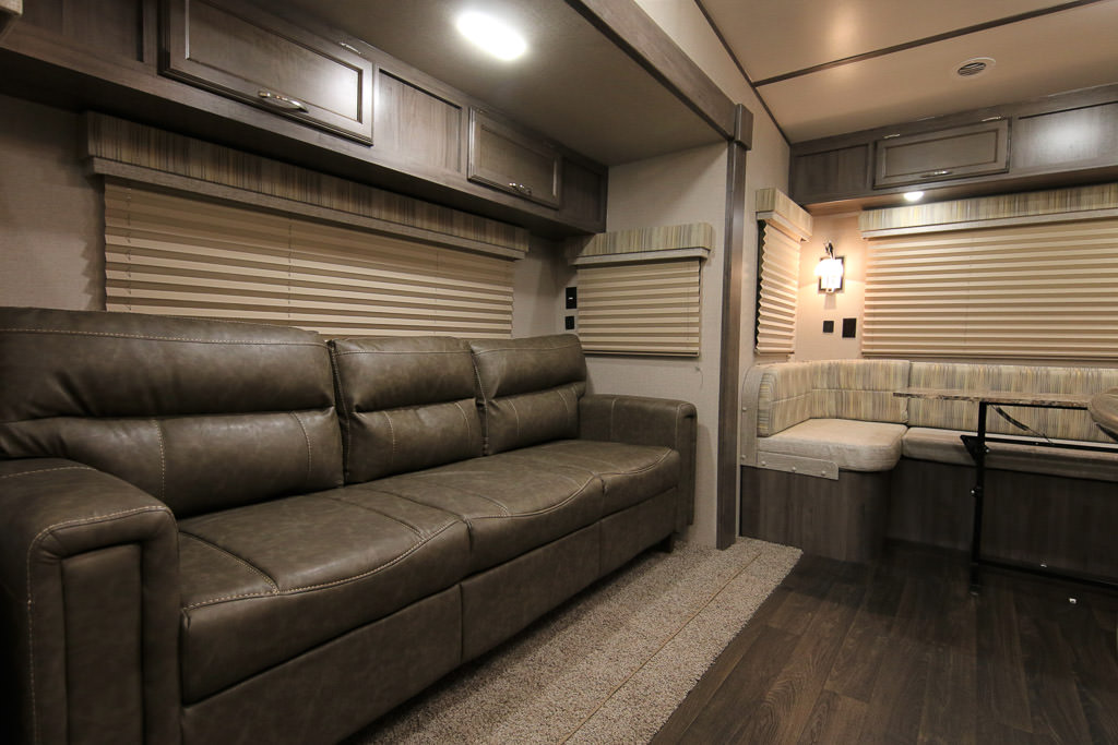Couch and dinette of Winnebago Minnie Plus Fifth Wheel.