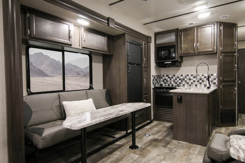 Kitchen and dinette of Winnebago Spyder.