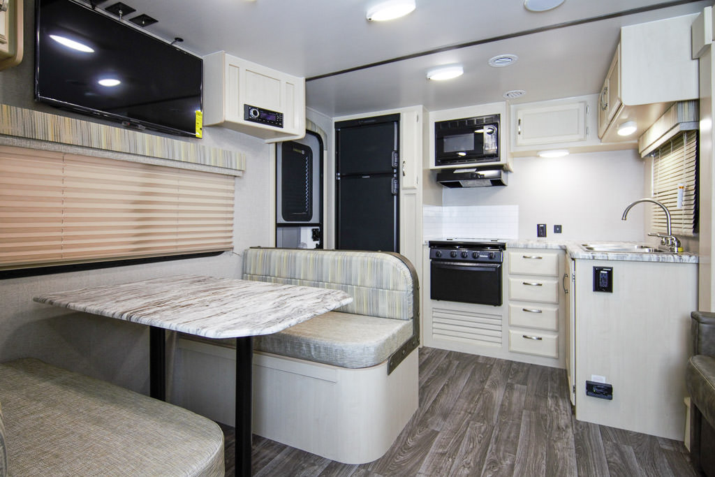 Dinette and kitchen of Winnebago Minnie Travel Trailer.