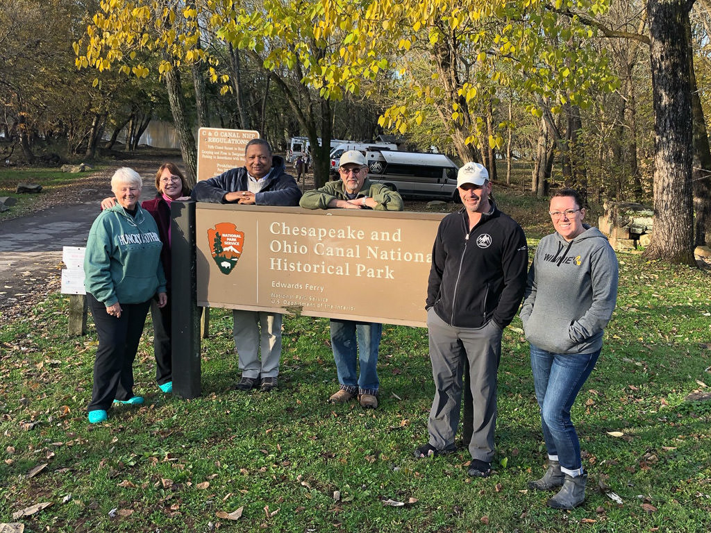 Travato owners in front of Chesapeake and Ohio Canal National Historic Park sign