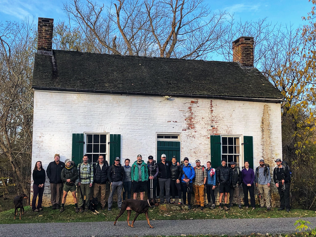 Warrior Expeditions group standing in front of white building before Veterans's Day hike