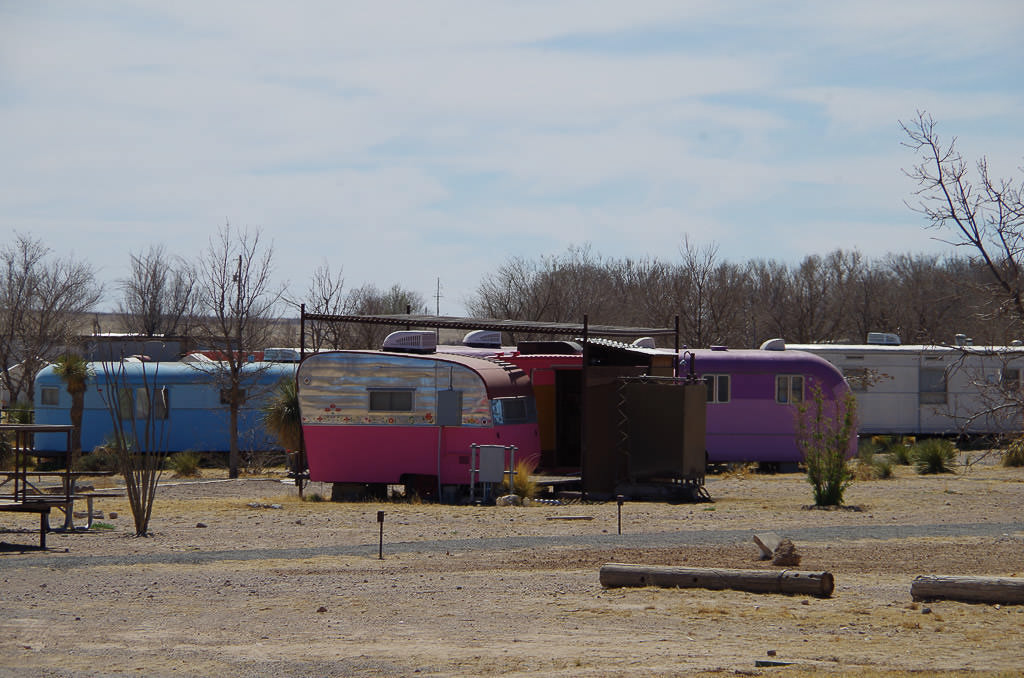 RV Park with colorful vintage trailers mixed among some newer ones.