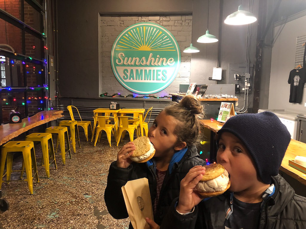 Kids eating huge ice cream sandwiches at Sunshine Sammies.