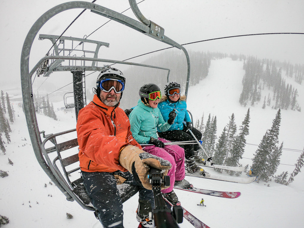 Family of three on a ski lift.