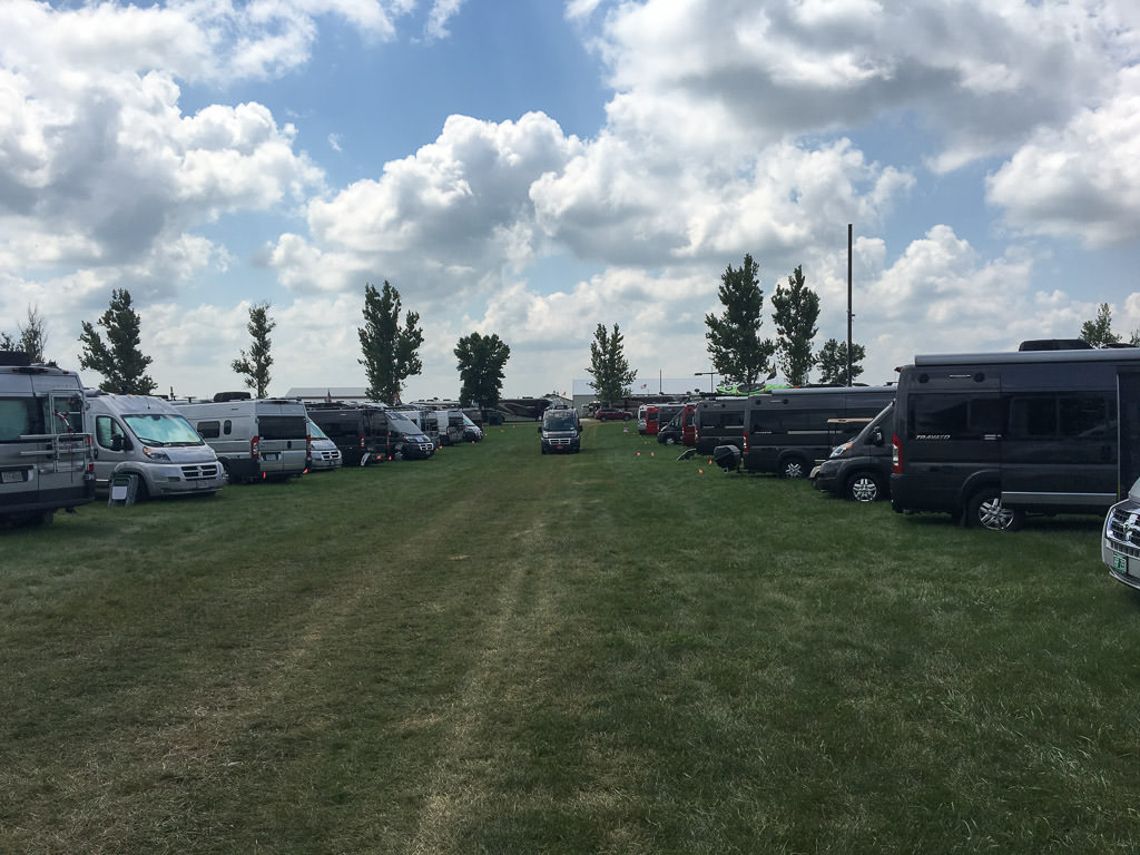 2 rows of Winnebago Class B vans parked at the Winnebago Grand National Rally.