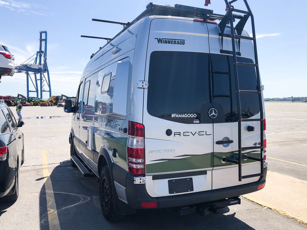 Winnebago Revel parked in parking lot.