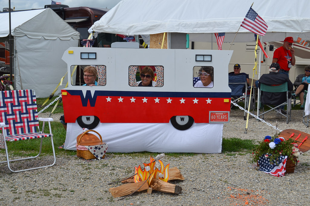 Rally attendees posing with small Winnebago cut out