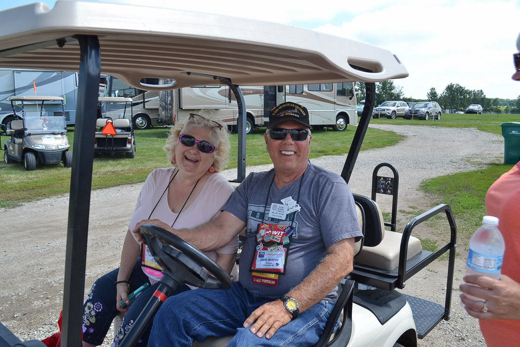 Two rally attendees on their golf cart